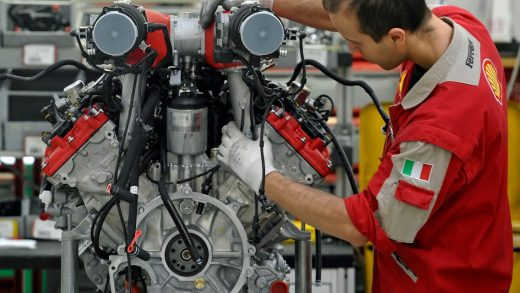 A technician work at the Ferrari department factory in Maranello, Italy. AP Photo/Marco Vasini