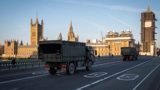 Military vehicles cross Westminster Bridge after members of the 101 Logistic Brigade delivered a consignment of medical masks to St Thomas' hospital on March 24, 2020 in London, England.