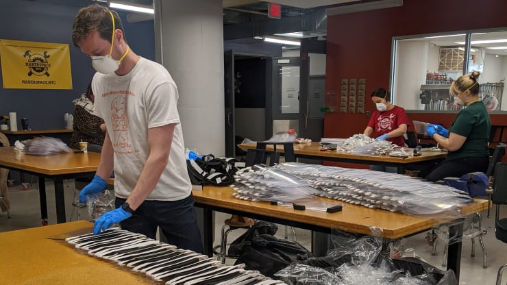 Workers at MakerSpace in New York City make face shields to assist with relief efforts during the coronavirus pandemic.