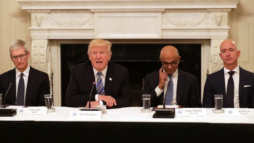 President Donald Trump speaks with Satya Nadella, Chief Executive Officer of Microsoft, and Jeff Bezos, Chief Executive Officer of Amazon during an American Technology Council roundtable in the State Dinning Room at the White House in Washington, DC on Monday, June 19, 2017.