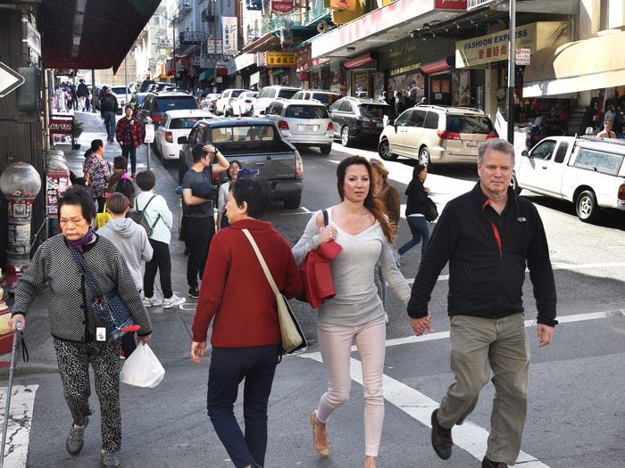 Tourists in Chinatown in 2018. Robert Alexander/Getty Images