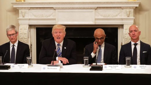 CEO of Apple Tim Cook , U.S. President Donald Trump, Microsoft CEO Satya Nadella and Amazon CEO Jeff Bezos attend a meeting of the American Technology Council in the State Dining Room of the White House June 19, 2017 in Washington, DC.