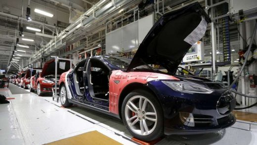 Workers assemble cars on the line at Tesla factory in Fremont. David Butow (Photo by David Butow/Corbis via Getty Images)