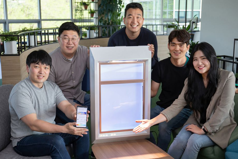 The SunnyFive team with their artificial window and companion app