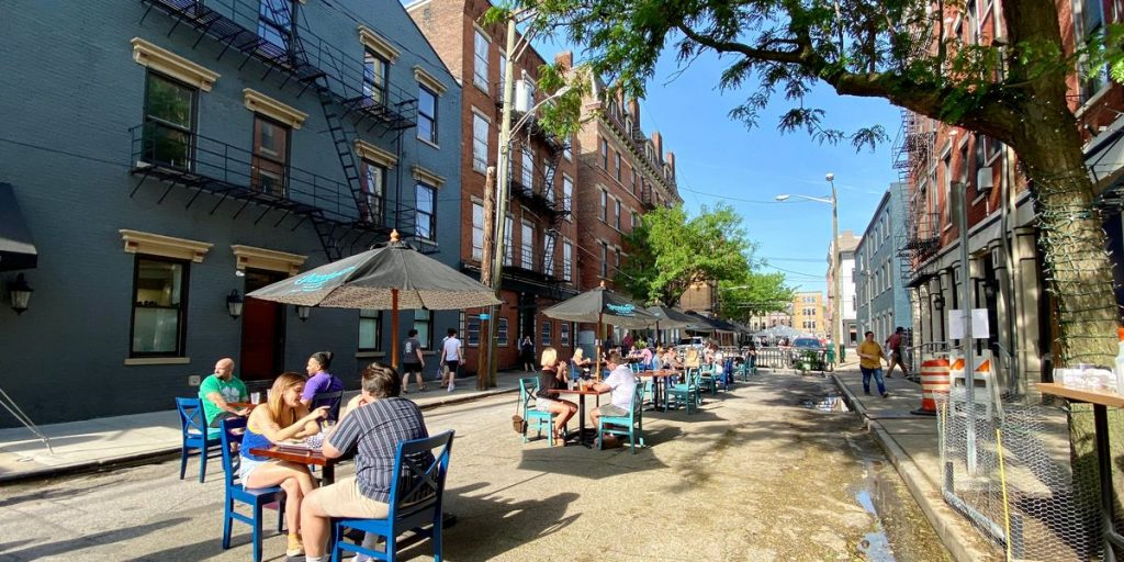People gather for food and drinks in the Over-the-Rhine District as restaurants and bars begin to reopen in the wake of the Coronavirus COVID-19 pandemic, on May 16, 2020, in Cincinnati, Ohio, United States.
