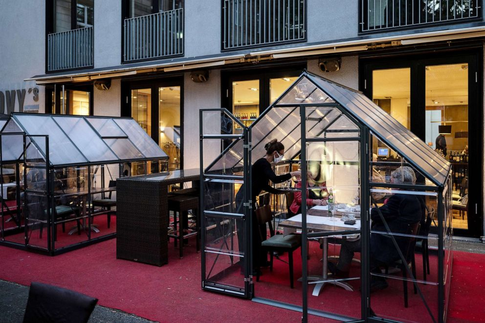 At Novy's Brasserie in Hagen, Germany, guests are served at tables in small greenhouses, to maintain social distancing rules during the coronavirus pandemic.