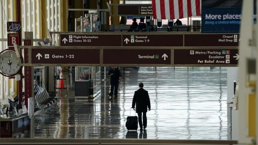 A passenger walks through Reagan National airport as the novel coronavirus (COVID-19) pandemic continues to keep airline travel at minimal levels and the U.S. economy contracts in the first quarter at its sharpest pace since the Great Recession, in Washington, April 29, 2020.