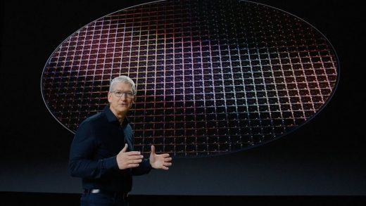 Apple CEO Tim Cook, with a wafer of Apple silicon in the background