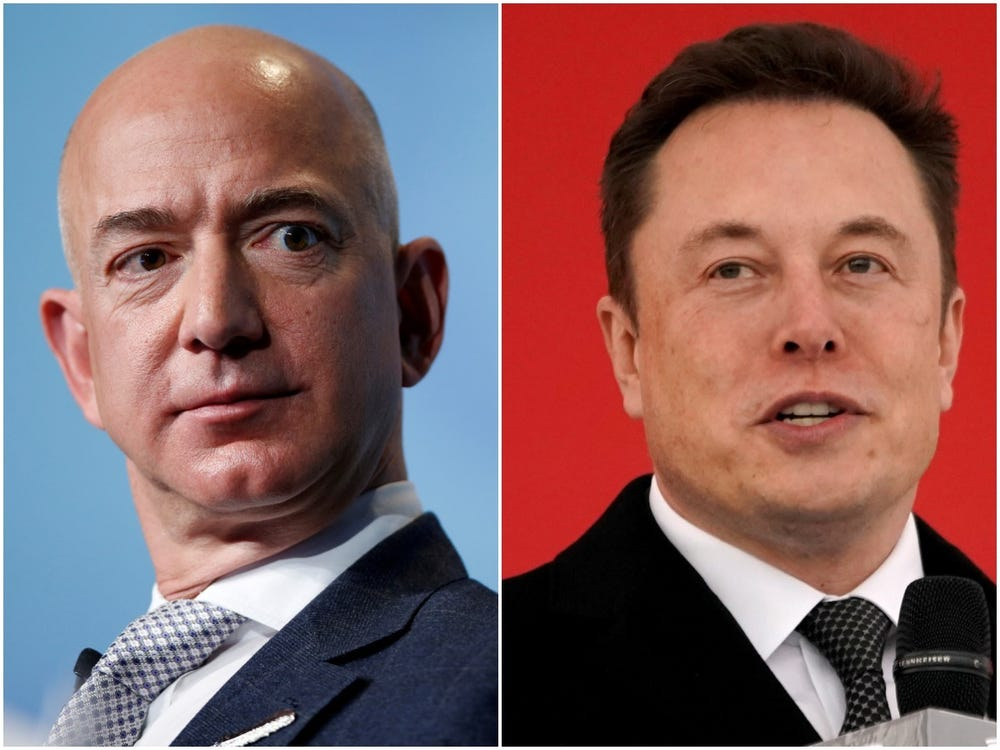 Amazon CEO Jeff Bezos, left, and Tesla and SpaceX CEO Elon Musk, right. REUTERS/Joshua Roberts