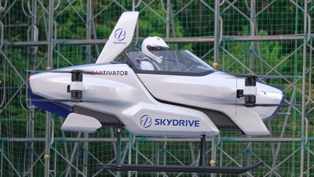 "This photo taken at the beginning of August, 2020 and released by ©SkyDrive/CARTIVATOR 2020, shows a test flight of a manned '""flying car"" at Toyota Test Field in Toyota, central Japan. Japan's SkyDrive Inc., among the myriads of ""flying car"" projects around the world, has carried out a"