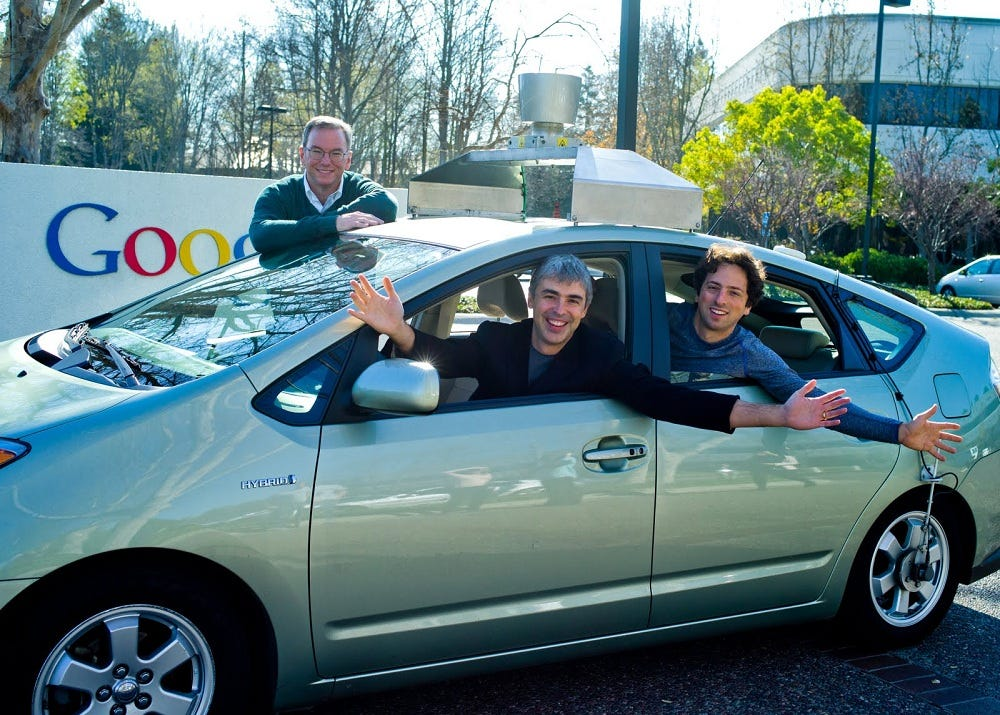 Former Google executive chairman Eric Schmidt (left) pictured with cofounders Larry Page (center) and Sergey Brin (right). Google