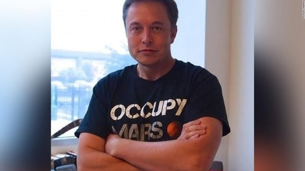 "Musk, in a photo posted to his Instagram, wears one of SpaceX's ""Occupy Mars"" t-shirts."