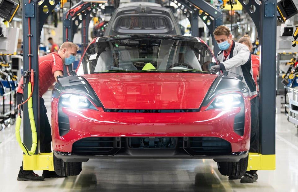 A Porsche Taycan being assembled. THOMAS KIENZLE/AFP via Getty Images