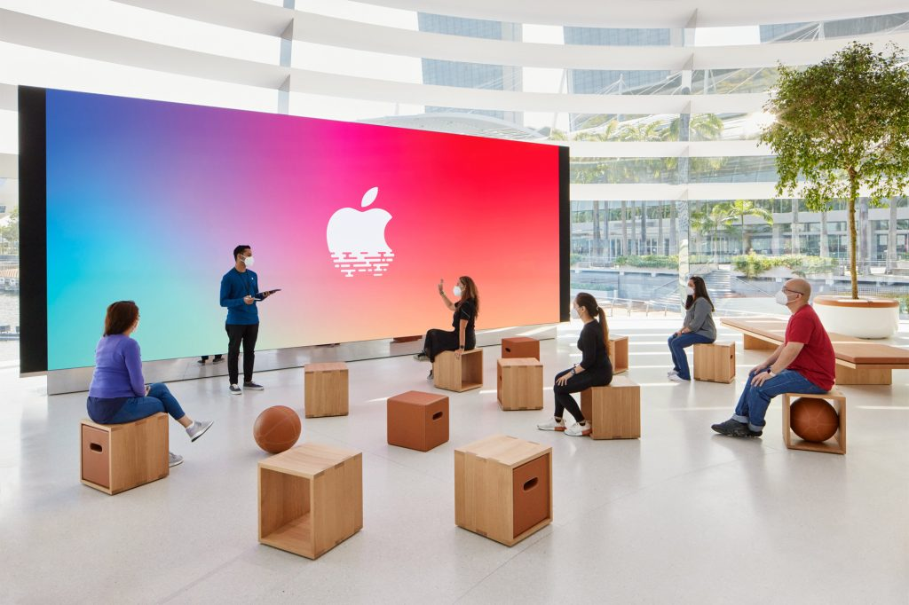 The store includes a video screen for presentations, tutorials, and talks. Image: Apple