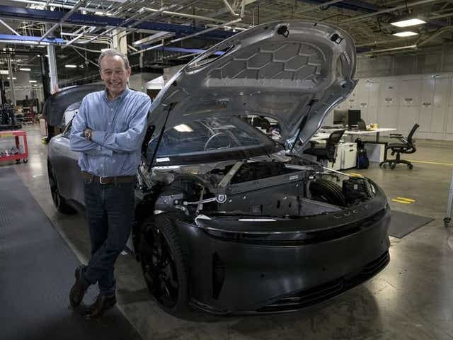 Peter Rawlinson, chief executive officer of Lucid Motors Inc., stands next to the Lucid Air prototype electric vehicle at the company's headquarters in Newark, Calif. DAVID PAUL MORRIS/ BLOOMBERG