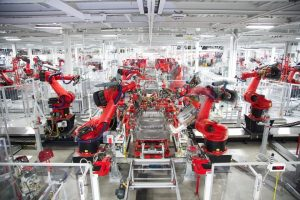 Robots assemble Tesla bodyframes at the company's California factory. Tesla