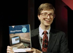 Microsoft co-founder Bill Gates with a boxed copy of Windows. Carol Halebia