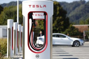 A Tesla Inc. Model S electric vehicle charges at a Supercharger station in Rubigen, Switzerland, on Thursday, Aug. 16, 2018. Tesla chief executive officer Elon Musk has captivated the financial world by blurting out via Twitter his vision of transforming Tesla into a private company. Photographer: Stefan Wermuth/Bloomberg via Getty Images