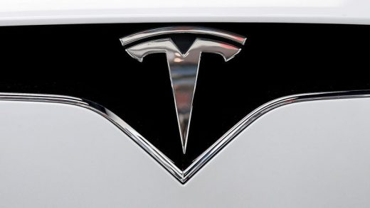 FILE PHOTO: The Tesla logo is seen on a car at Tesla's new showroom in Manhattan's Meatpacking District in New York City, U.S., Dec. 14, 2017. REUTERS/Brendan McDermid/File Photo