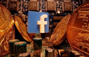 A 3D-printed Facebook logo and representations of cryptocurrency are standing on a motherboard in this picture illustration taken April 17, 2020. REUTERS/Dado Ruvic/Illustration