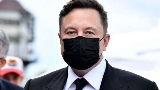 Futurist entrepreneur Elon Musk wears a face mask as he arrives to attend a meeting with the leadership of the conservative CDU/CSU parliamentary group in Berlin on Wedmesday, Sept. 2, 2020. (Tobias Schwarz/Pool via AP)