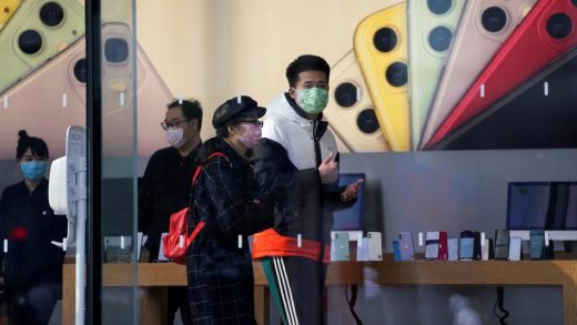 People wearing protective masks are seen in an Apple Store, as China is hit by an outbreak of the new coronavirus, in Shanghai, China, January 29, 2020. Picture taken January 29, 2020. REUTERS/Aly Song