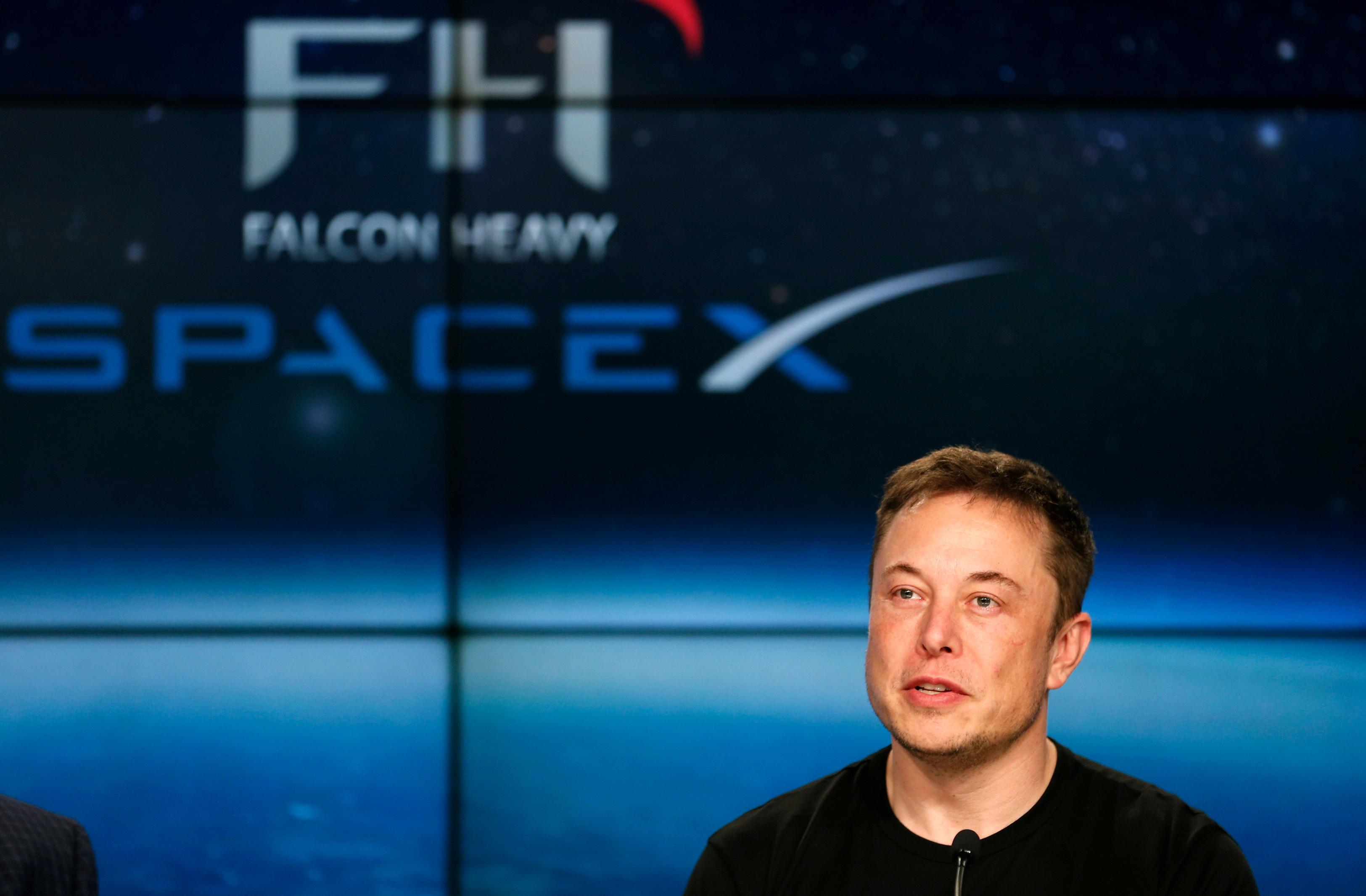 SpaceX founder Elon Musk speaks at a press conference following the first launch of a SpaceX Falcon Heavy rocket at the Kennedy Space Center in Cape Canaveral, Florida, U.S., February 6, 2018. REUTERS/Joe Skipper/File Photo - RC15B6B3A870