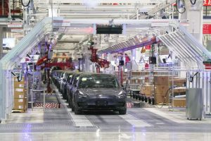 A Model 3 vehicle moves off an assembly line during a ceremony at Tesla's Gigafactory in Shanghai, in December 2019