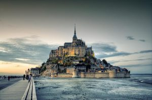 The Mont Saint-Michel abbey in Northern France is [-] near the village of Saint-Senier-de-Beuvron GETTY
