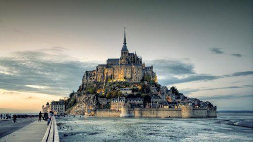 The Mont Saint-Michel abbey in Northern France is [-] near the village of Saint-Senier-de-Beuvron GETTY