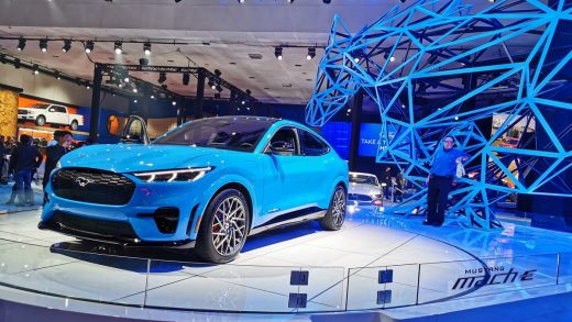People visit Ford's all-electric SUV Mustang Mach-E at the 2019 Los Angeles Auto Show in Los Angeles, the United States, Nov. 22, 2019.
