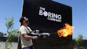 An attendee operates a Boring Co. flamethrower at the company's photo booth during an unveiling event for the Boring Co. Hawthorne test tunnel in Hawthorne, California. Robyn Beck/Pool via REUTERS
