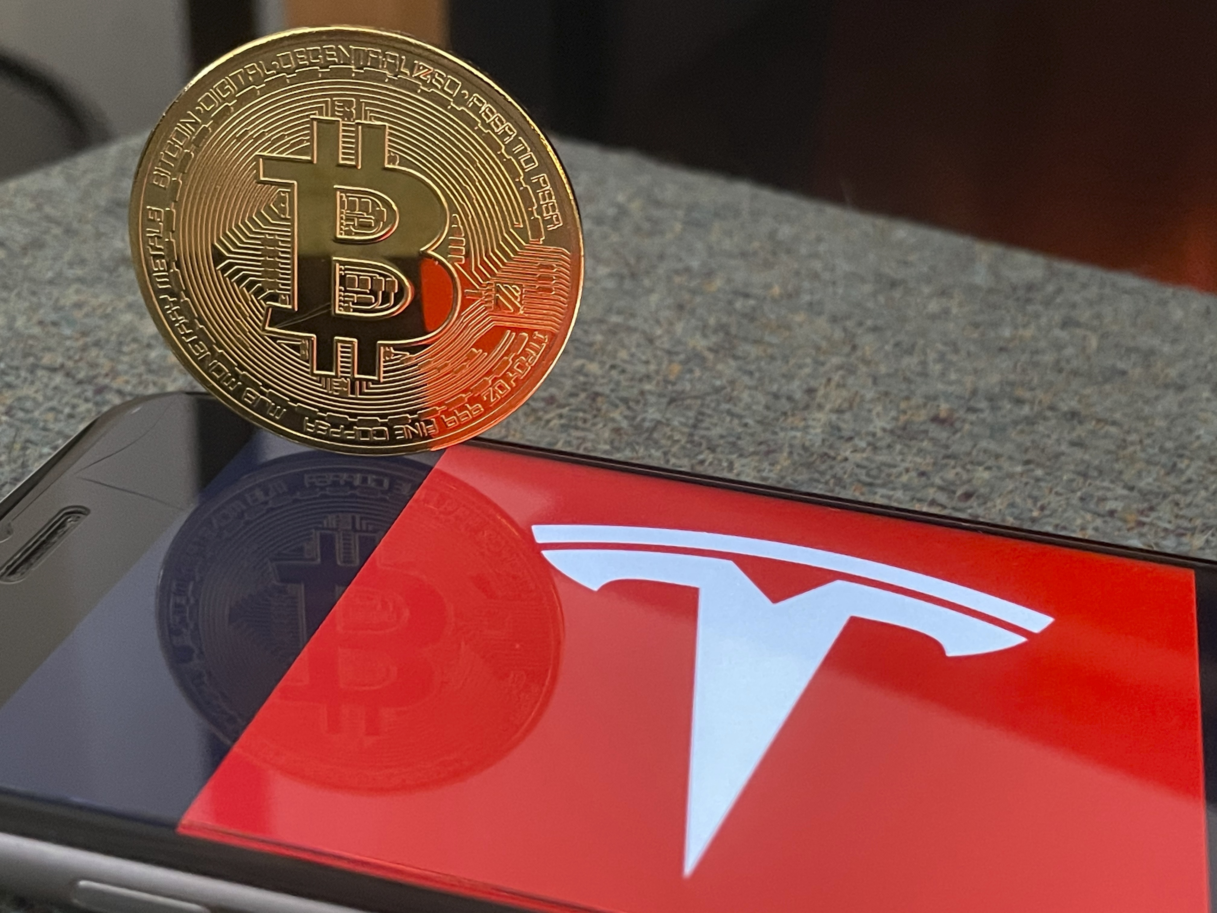 Photo by: STRF/STAR MAX/IPx 2021 2/8/21 Tesla buys $1.5 Billion in bitcoin, plans to accept it as payment. STAR MAX Photo: Tesla logo photographed off an iphone 6s.