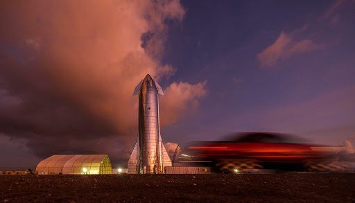 The sky begins to light up before sunrise over a prototype of the SpaceX Starship at the SpaceX launch facility in Boca Chica.(Smiley N. Pool / Staff Photographer)