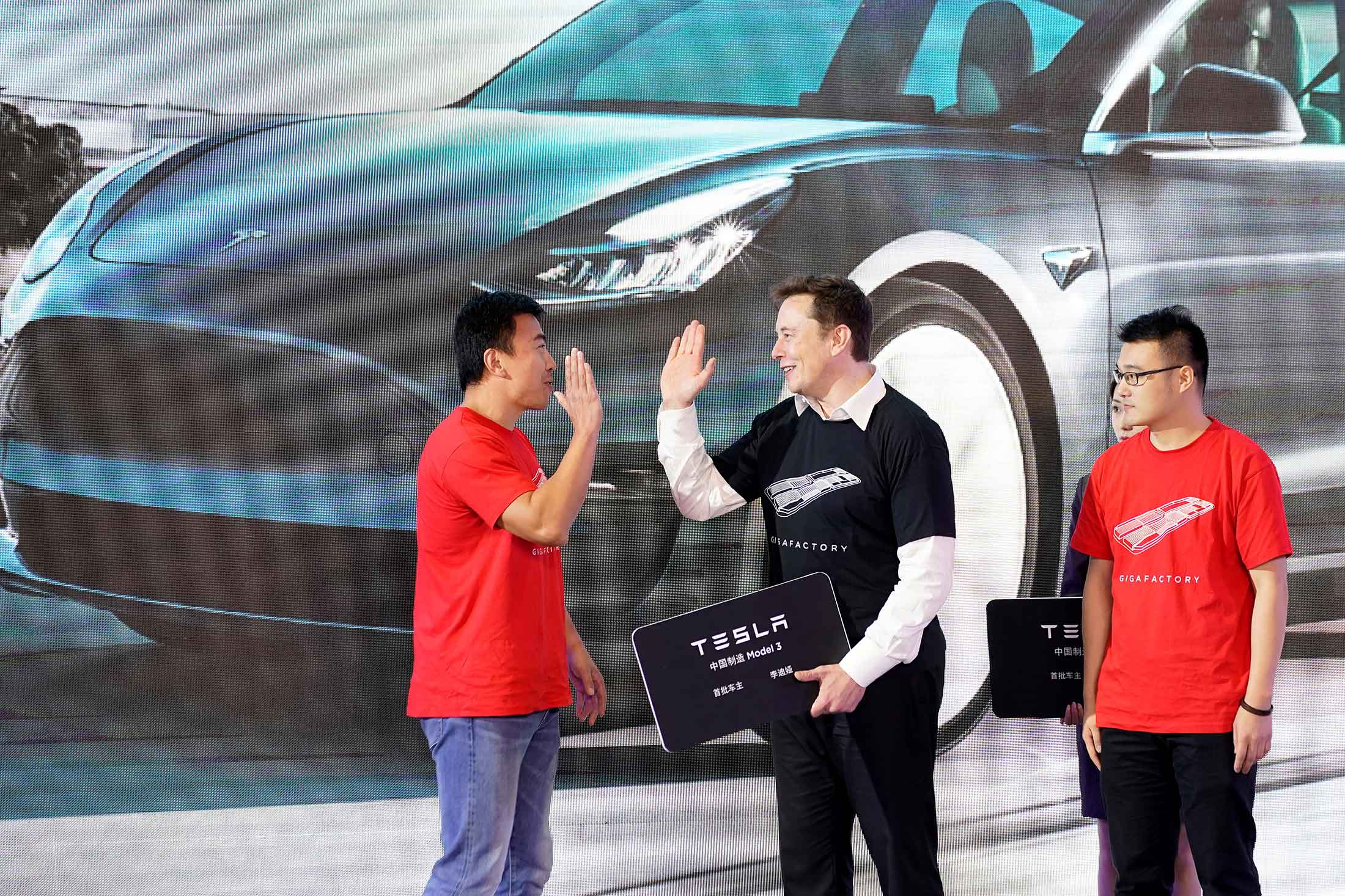 Musk greeting Model 3 vehicle owners in Shanghai. Photographer: Aly Song/Reuters