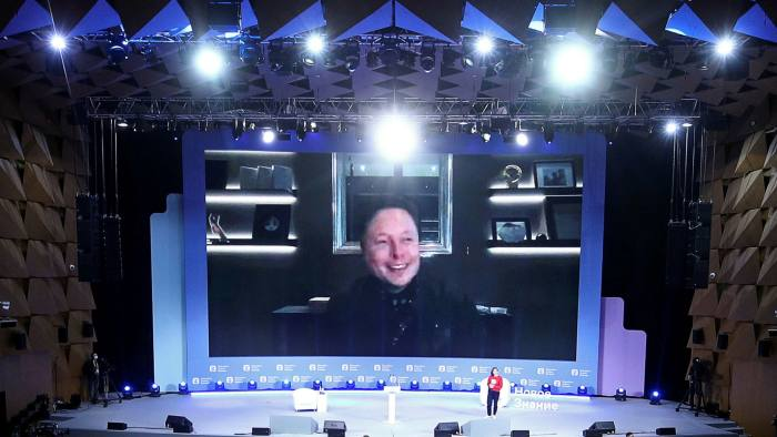 Elon Musk appearing via videolink at the New Knowledge forum in Moscow