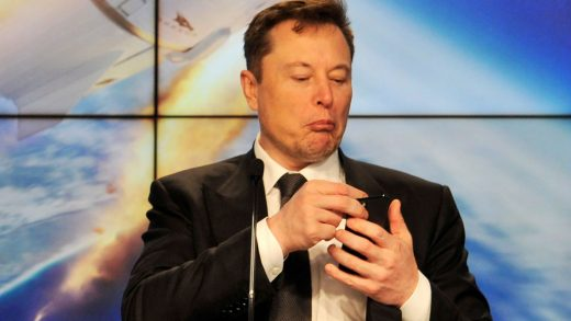FILE PHOTO: SpaceX founder and chief engineer Elon Musk looks at his mobile phone during a post-launch news conference to discuss the SpaceX Crew Dragon astronaut capsule in-flight abort test at the Kennedy Space Center in Cape Canaveral, Florida, U.S. January 19, 2020. REUTERS/Steve Nesius/File Photo