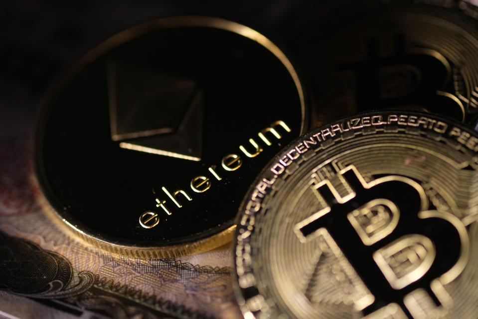 Competition between bitcoin and ethereum has[-] heated up over recent months as the price of the two rival tokens has rocketed higher. GETTY IMAGES