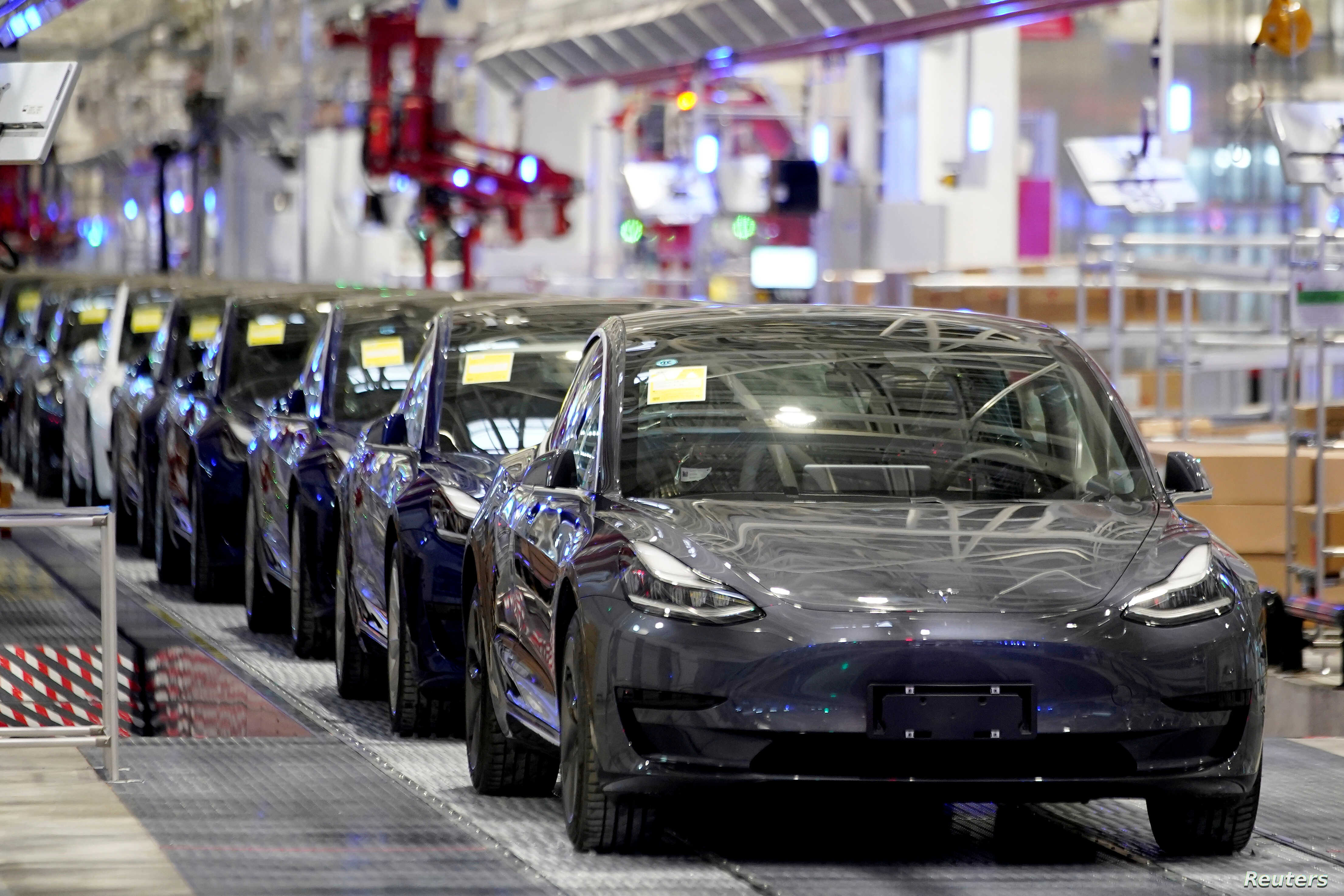 Tesla China-made Model 3 vehicles are seen during a delivery event at its factory in Shanghai, China January 7, 2020. REUTERS/Aly Song - RC2YAE9II6HS