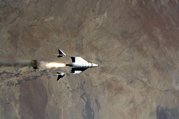 VSS Unity fires its rocket engine shortly after launching on its third spaceflight on May 22, 2021.