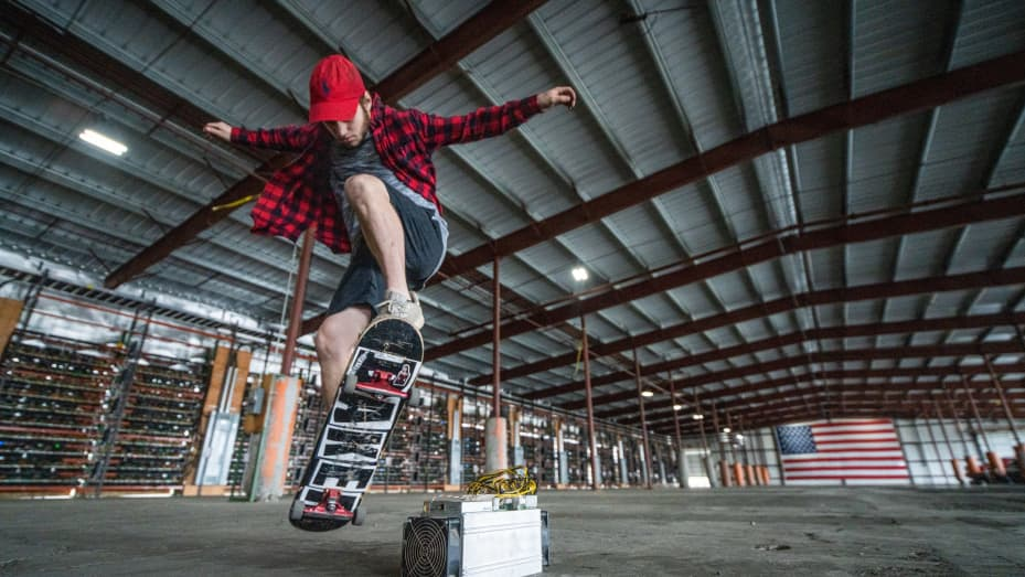 Bitcoin miner Zack Pettit skating on his work break at the SCATE Ventures mining facility in Dallesport, Washington.