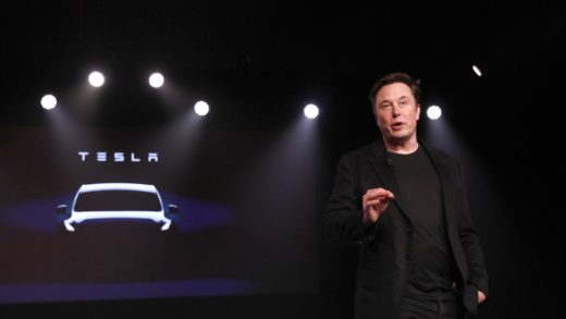 Elon Musk, co-founder and chief executive officer of Tesla Inc., speaks during an unveiling event for the Tesla Model Y crossover electric vehicle in Hawthorne, California, U.S., on Friday, March 15, 2019. Musksaid the cheaper electric crossover sports utility vehicle (SUV) will be available from the spring of 2021. The vehicle's price will start at $39,000, a longer-range version will cost $47,000. Photographer: Patrick T. Fallon/Bloomberg via Getty Images