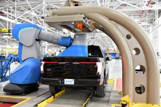 One year after Ford confirmed construction of the Rouge Electric Vehicle Center in Dearborn, Mich., the first Ford F-150 Lightning pre-production units begin leaving the factory. Pre-production model shown. F-150 Lightning available starting spring 2022.