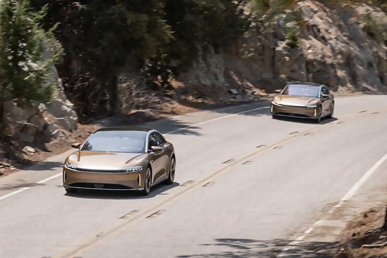 A lucid dream is one in which you are aware you are dreaming and can exert some degree of control. That seems to describe the state of mind of those who brought the all-wheel-drive Lucid Air Dream Edition to life because, by all rights, it shouldn't exist. The team that CEO Peter Rawlinson assembled not only was building the airplane while they were flying it, they were also hyping and financing the complicated endeavor at the same time. On paper, the results are just as jaw-dropping as they are easy to disbelieve. How could a first-time carmaker burst out of the gate with a stunner of an all-electric sedan that produces an eye-watering 1111 horsepower and 471 miles of EPA range in Performance spec and delivers an unprecedented EPA range of 520 miles in the 933-hp Range spec? The gracefully styled Air looks long, low, and wide, so it just has to be a portly sled that's hiding a huge battery pack and a massive pair of motors, right?