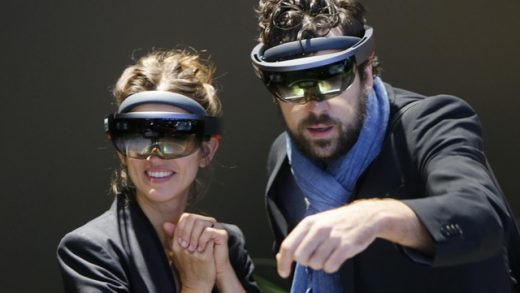 Attendees at the International Frankfurt Motor Show try out the HoloLens.