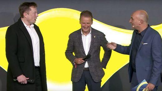 Tesla CEO Elon Musk and Volkswagen CEO Herbert Diess exchange compliments at an award ceremony.