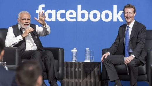 Narendra Modi, India's prime minister, speaks as Mark Zuckerberg, chief executive officer of Facebook, listens during a town hall meeting at Facebook headquarters in Menlo Park, California.