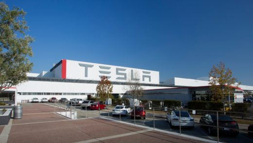 Workers assemble cars on the line at Tesla's factory in Fremont, California.