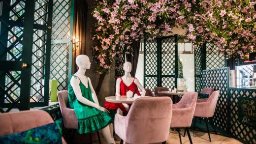 Mannequins show off local fashion designers' clothes at a restaurant in Vilnius, Lithuania, in an initiative designed to maintain social distancing. Lithuania eased lockdown restrictions on May 18, 2020.