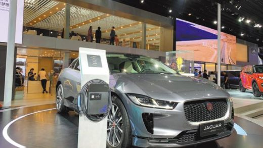 Jaguar showcases its electric model I-Pace with its charging pole at the 2018 Guangzhou auto show. [Photo by Zhang Dandan/China Daily]